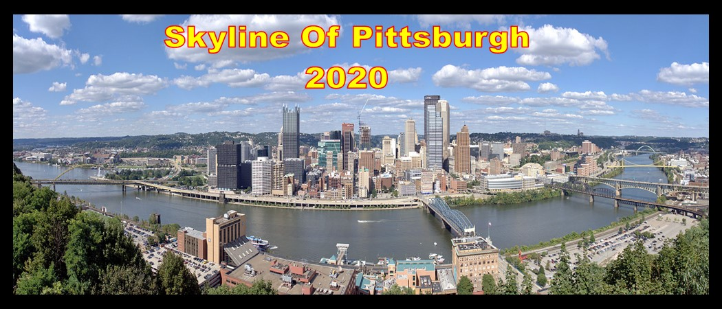 Skyline of Pittsburgh from Mt Washington showing Smithfield, Ft Pitt Bridge and 4 other bridges with white clouds and blue sky in 2020